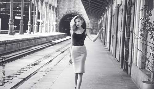 Fashionable girl posing on railway.
