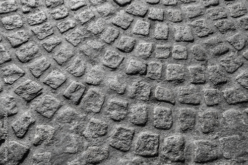 Background texture. Gray granite cobblestone road pavement