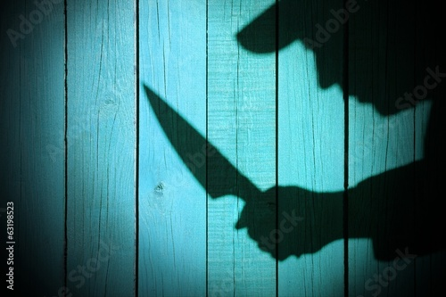 Armed Criminal Man Silhouette on natural wooden background, XXXL