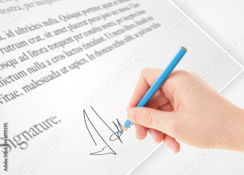 canvas print picture Hand writing personal signature on a paper form