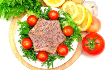 Aspic from meat with lemon, mustard and fresh vegetables