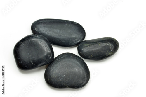 Stack of black stones indicate the concept of balance