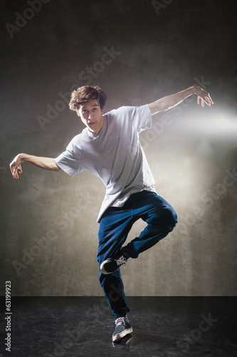 urban hip hop dancer over grunge concrete wall