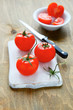 red tomatoes on chopping board