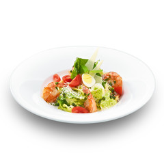 Fresh delicious italian caesar salad with royal shrimps. Isolate