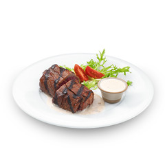 Delicious grilled tenderloin steak. Isolated on white