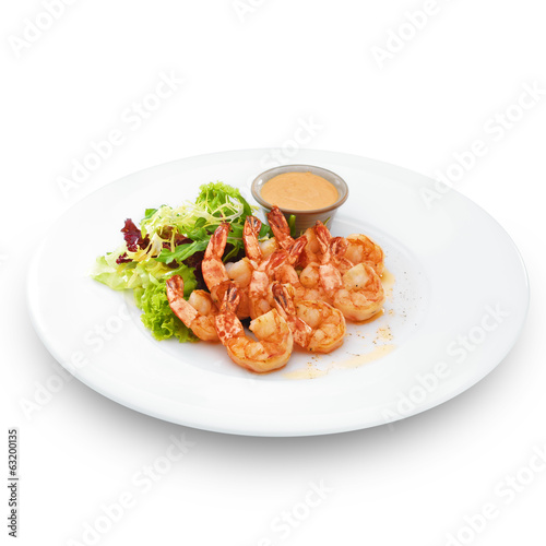 Delicious healthy cooked royal shrimps. Isolated on white