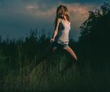 Girl dancing in grass