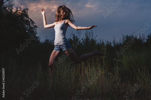 Female dancing in a evening