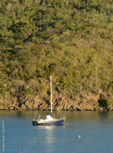 Sailboat near exotic coast