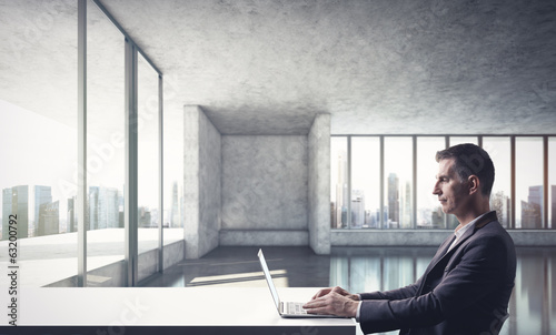 Businessman working in bright modern office
