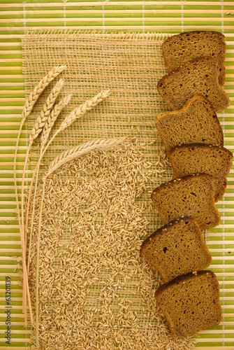 image of bread and wheat on the gunny