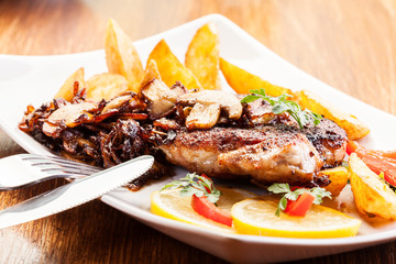 Fried pork chop with mushrooms and chips