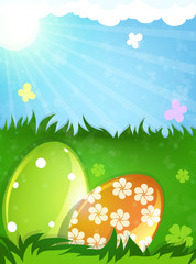 Easter eggs in the spring meadow
