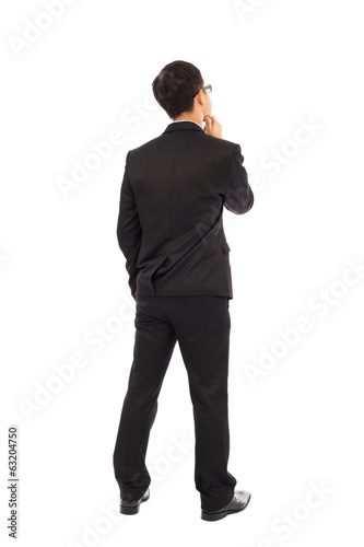 Thinking businessman isolated on white background