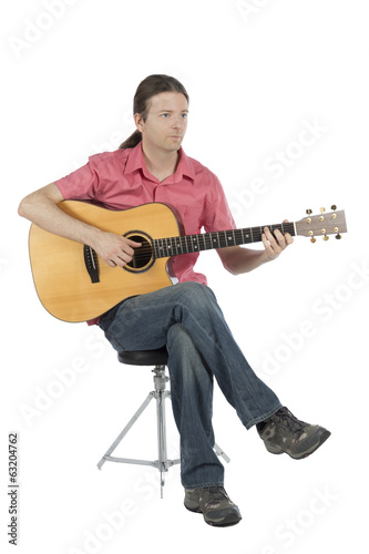 Guitarist  with his guitar, portrait view
