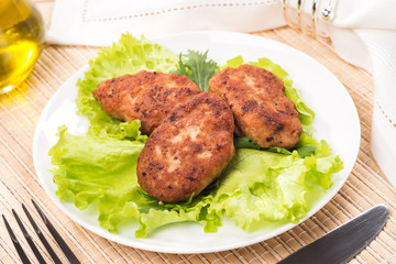 Fried meatballs with lettuce on a plate