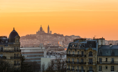 View of Montmartre and Paris rooftops at sunset from les Buttes