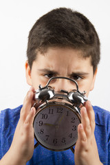 The Boy Is Holding Clock