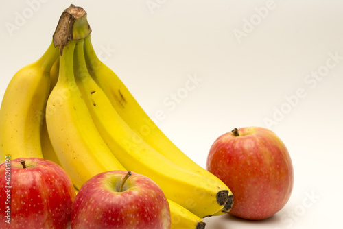 Bananas and apples isolated on white