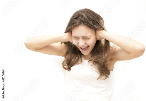 girl shouts closing ears with hands