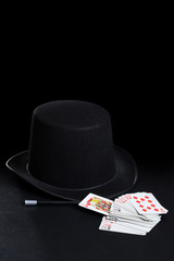 magician hat wand and cards