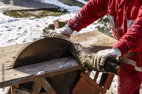Man working with circular saw blade