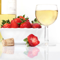 whie  wine bottle and glass and fresh strawberries isolated on w