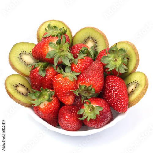 Bowl of fresh kiwi and delicious ripe strawberries isolated on w