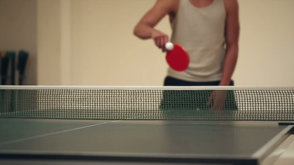 Anonymous people playing table tennis