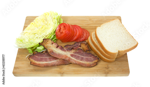 Bacon lettuce tomato bread on cutting board