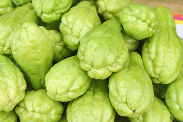 Pile chayote fresh vegetables on the market