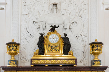 Antique clock in gold case in the interior Hermitage Museum