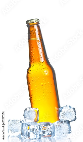bottle of fresh beer with ice and drops,fresh beer on summer