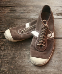 Old shoes on wooden floor