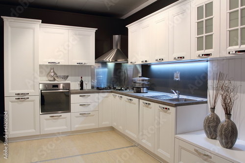 Fotobehang Stad gebouw Modern cream coloured kitchen