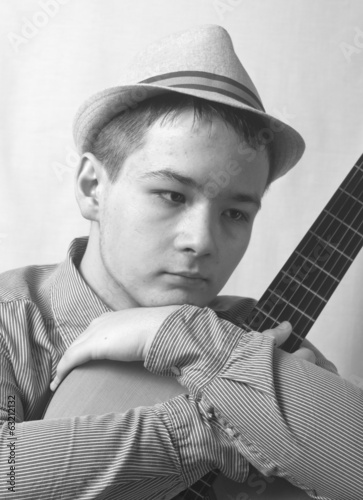 pensive teenager with guitar