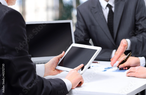 modern business team using tablet computer to work