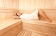 Photo of sexy slim woman lying at sauna