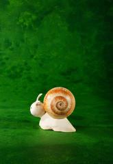 cute puppet handmade, small snail, green background