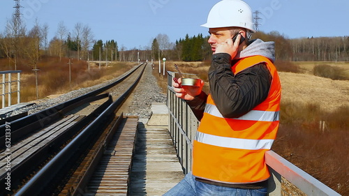 Worker with cell phone and canned meat
