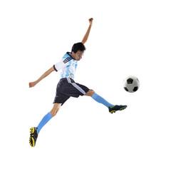 Football player kicking ball isolated