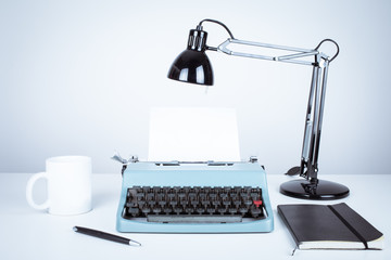 vintage typewriter and desk with lamp