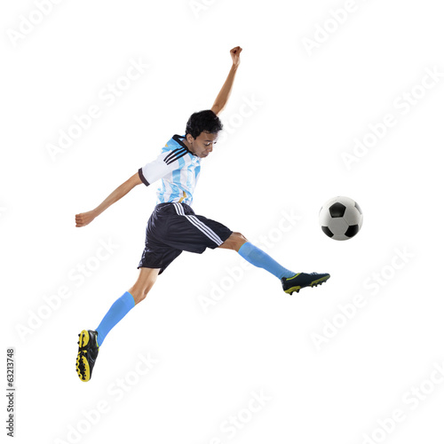 Football player kicking ball isolated