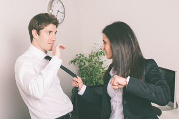 Bully Businesswoman Holding Colleague's Necktie