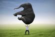 Man lifting heavy elephant