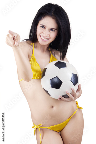 Pretty woman with a soccer ball isolated