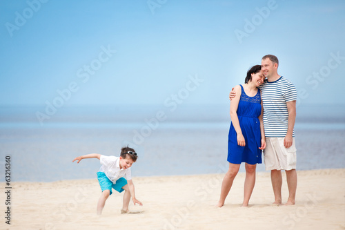 Happy beautiful family on tropical beach vacation