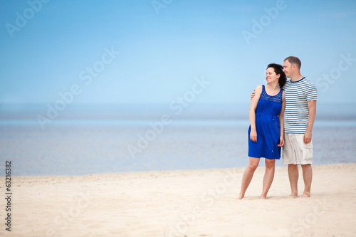 Young couple at tropical beach on summer vacation