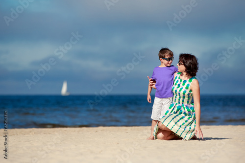 Young mother and her son on summer vacation